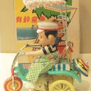 1960s Chinese wind-up boy on tricycle. Original box. With Key